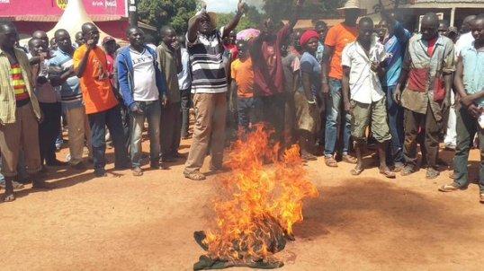 Hon. Otto Odongo Happy Burning Anti JPAM T-shirts in Lira 25.11.15