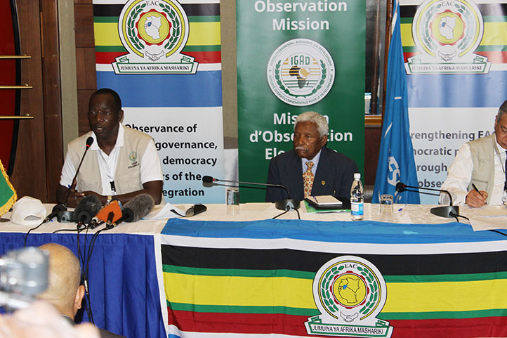 Igads-head-of-Election-observer-team-Yufnalis-Okubo-left-and-former-TZ-president-Ali-Hassan-Mwinyi-who-lead-the-EAC-team-addressing-joint-press-conference-last-friday-at-Sheraton